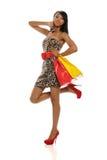 amerykanin afrykańskiego pochodzenia zdojest mienia zakupy kobiety potomstwa Zdjęcie Royalty Free
