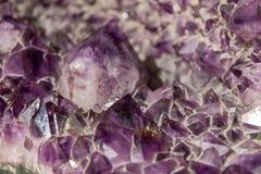 Amethyst crystal background. Natural violet amethyst crystal background royalty free stock images