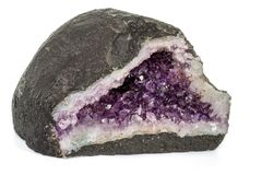 Amethyst Crystal Druse macro mineral on white background. Close up stock photos