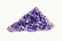 Amethyst crystal geode. Purple to blue Amethyst crystal geode cut isolated on white background Stock Image