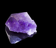Amethyst crystal over black background Stock Photography