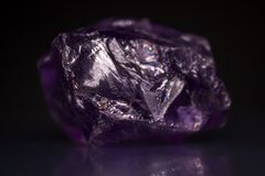 Amethyst Crystal Stone. On black background royalty free stock images