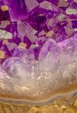 Amethyst crystals with rock part of amethyst stone. Amethyst stone crystals with rock part of amethyst. Macro photo. Yellow ones are calcite crystals royalty free stock photo