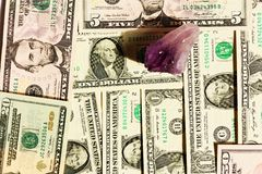 Amethyst and dollars Stock Images