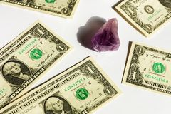 Amethyst and dollars Royalty Free Stock Photos