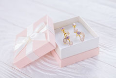 Amethyst earrings in the gift box Stock Photo