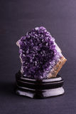 Amethyst geode on black background Stock Image