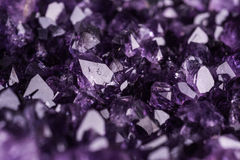 Amethyst geode on black background Stock Photos