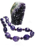 Amethyst geode crystals and jewelery beads Stock Photography