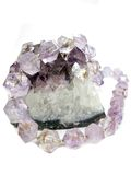 Amethyst geological crystals and jewelery beads Royalty Free Stock Photos