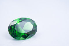 Amethyst Jewel. Green amethyst jewel on grey background royalty free stock photography