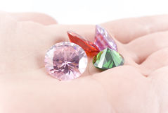 Amethyst Jewel. In womans hand Stock Photos