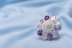 Amethyst jewel. Amethyst ring  jewel on a blue textile surface Royalty Free Stock Photos