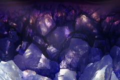 Amethyst macroshot blue background Royalty Free Stock Image