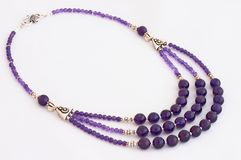 Amethyst necklace. Beautiful amethyst necklace over white Royalty Free Stock Images