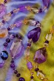 Amethyst necklace on multicolored silk Stock Photography