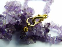 Amethyst necklace on white background Royalty Free Stock Photos