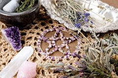 Free Amethyst Pentagram With Dried Herb Bundles, Mortar And Pestle On Crotchet Jute Altar Cloth - With Selenite And Rose Quartz Stock Image - 131543251