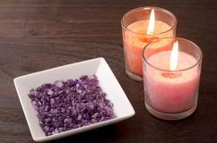 Amethyst and two candles Royalty Free Stock Images