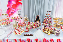 Amezing dessert stand with a lot of delicious sweets Stock Photography