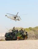 Amfibisk personalbärare och helikopter Royaltyfria Bilder