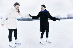 Ami de enseignement à patiner Image libre de droits