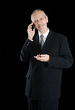 Amiable and Smiling Businessman on Phone Royalty Free Stock Images