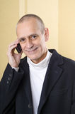 Amiable and Smiling Man on Phone Stock Photos