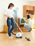 Amicable couple doing housework Stock Photos