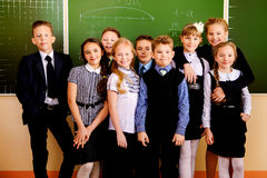 Amicable guys. Happy schoolchildren at a classroom. Education stock images