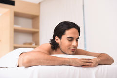 Amicable man dreaming in spa salon Stock Photo