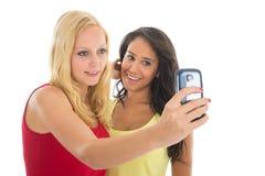 Amiche che prendono selfie Fotografia Stock