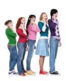 Amici che comunicano dal telefono Immagine Stock