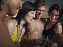 Amici che tostano Champagne Outdoors Fotografia Stock