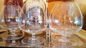 3 amici Cognac. Bicchieri Chivas Polignac Royalty Free Stock Photography