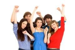 Amici con le braccia alzate Immagini Stock
