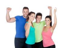 Amici felici di forma fisica che celebrano qualcosa Fotografia Stock