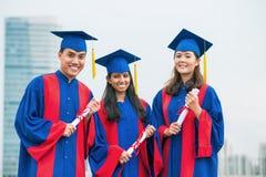 Amici graduati Immagini Stock