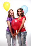 Amies et ballons Photo stock