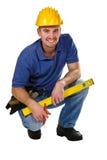 Amigáveis novos agacham-se trabalhador manual Imagem de Stock Royalty Free