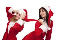 Amigas no traje de Santa foto de stock royalty free