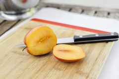 Amigo Pluot Sliced Open with a Knife royalty free stock image