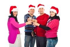 Amigos alegres de Navidad que tuestan con champán Fotografía de archivo libre de regalías