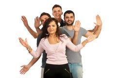 Amigos alegres que muestran sus palmas Imagen de archivo