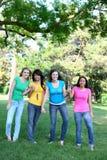Amigos de muchacha en el parque Fotos de archivo libres de regalías