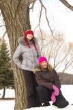 Amigos de muchacha en un árbol Imágenes de archivo libres de regalías