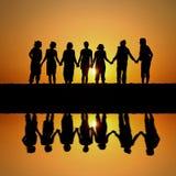 Amigos do por do sol Imagens de Stock Royalty Free