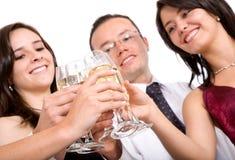 Amigos em um partido Fotos de Stock Royalty Free