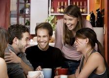 Amigos em uma casa de café Foto de Stock Royalty Free