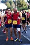 Amigos en un medio maratón Imágenes de archivo libres de regalías